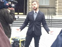 Ben Makuch stands outside of Osgoode Hall March 6. File photo